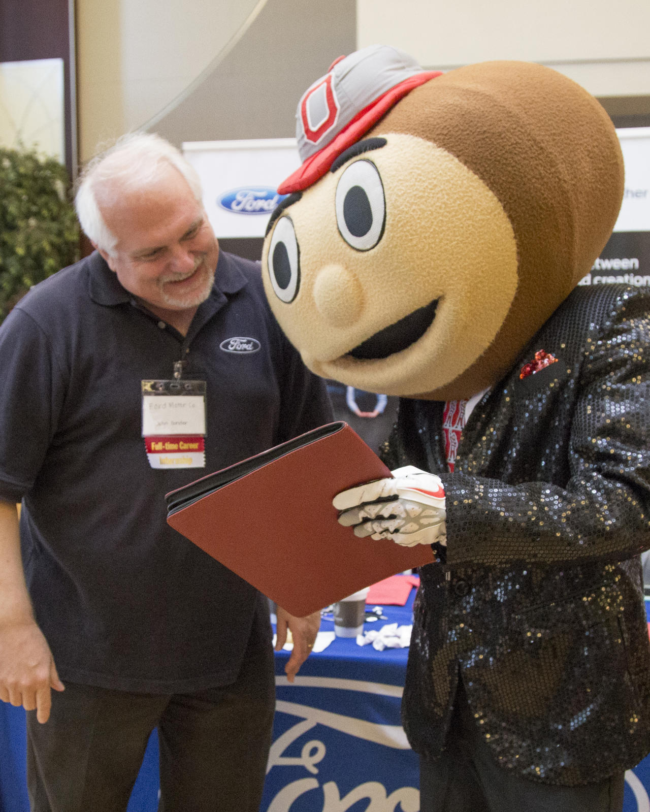Brutus sharing his resume with an employer